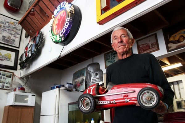 "Stan Betz holds a miniature roadster from the 1950 film, To Please a Lady. His collection of around 60 classic movie miniatures was featured on an episode of ""Visiting With Huell Howser."""
