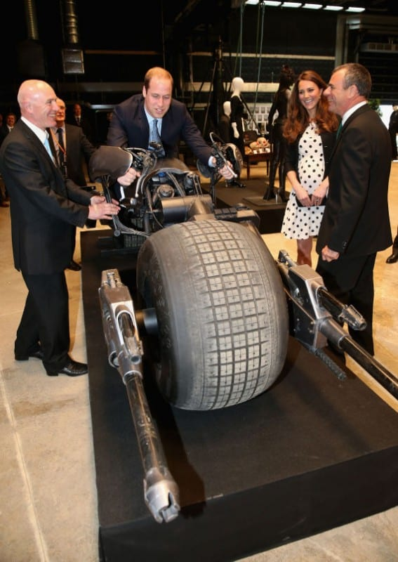 The Duchess of Cambridge watches as Duke of Cambridge sits on the 'Batpod' during their visit to Warner Bros studios in Leavesden, Herts where the popular Harry Potter movies were produced.